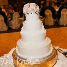 They chose an ivory buttercream cake accented with lace details and topped off with fresh roses.