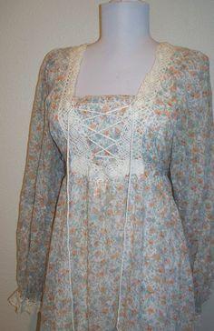 Vintage 70s Romantic earth tone floral corset maxi peasant dress. $25.00, via Etsy.