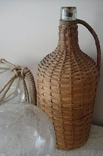 wicker covered bottle. paint and use as taper candle holder
