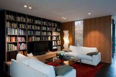 comfortable white fluffy couch perfect for afternoon reading at your personal library