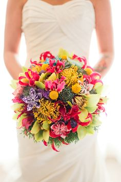 The bride's elaborate bouquet included origami details, which channeled her colorful personality. | www.BridalBook.ph #weddings #bouquet