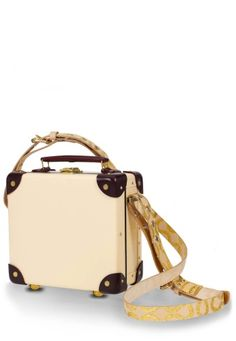 Vivienne Westwood Loves Mini Utility Case has been designed in elegant cream with burgundy leather corner/trim detail and polished brass hardware. The interior, Westwood's signature red tartan, mirrors the Vivienne Westwood Loves Cashmere Shawl. Finished with luggage belts which feature Westwood's iconic Squiggle prints, as first appeared in the Autumn/Winter 1981 Pirate collection in natural/gold.