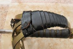 The leather wrapping on the hilt (sans sword knot)
