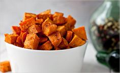 Coconut-oil-roasted sweet potatoes; the oil enhances their caramelized flavor. Photo: Andrew Scrivani for The New York Times