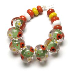 'Meadow' ~ £28.00 #lampworkbeads #poppies #daisies #beadsbylaura