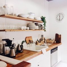 super simple yet quite stylish kitchen hanging shelves Minimilist. possibly steel cable?