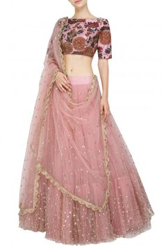 Mrunalini Rao creates a soft, magical look in this pale pink tiered lehenga and koela print blouse. Stye it with gold jhumkas and bangles for a gorgeous look. Dress Indian Style, Indian Fashion Dresses, Indian Designer Outfits, Designer Dresses, Half Saree Designs, Lehenga Designs, Indian Lehenga, Lehenga Choli, Net Lehenga