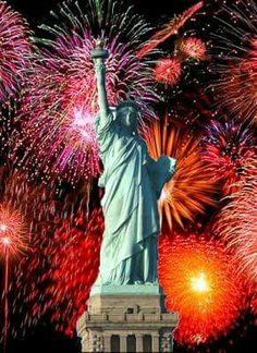 Fireworks over the Statue of Liberty and New York Harbor.