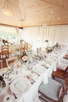 As a wedding photographer and someone who have passion for home decoration, this is really neat. http://toussaintweddingphotographer.com/. Eclectic mix of chairs and a dreamy bunch of flowers lining the table ~ so fun! Photography by simplybloomphotography.com, Floral Design by sweetpea-flowers.com, Event Styling by worthwhilestyle.com