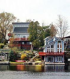 We boat past this fantastic cottage in the summer up on Sturgeon Lake in Kawartha Lakes, Ontario. This Cottage and Boat House Bunkie Apartment are for rent too apparently! Ontario, Cottage Rentals, Large Families, Boat House, Mansions, House Styles, Lakes, Cottages, Summer