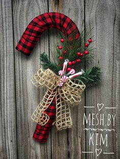 Best 12 This beautiful Buffalo plaid candy cane door hanger needs a new home! Based with Buffalo plaid ribbon and topped with winter florals and a window pane bow! It's alse features faux peppermint candy! This door hanger is perfect for indoor or outdoor Christmas Candy, Rustic Christmas, Christmas Holidays, Christmas Decorations, Christmas Ornaments, Christmas Door, Plaid Christmas, Christmas 2019, Christmas Island