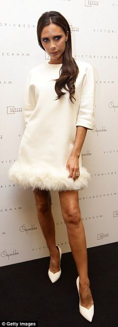 Victoria Beckham wore a dress from her own autumn/winter 2014 collection. On Pedder store event, Singapore – May 12 2014
