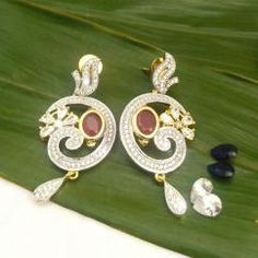 Party Wear American CZ Diamond Gold Plated Earrings With Changable Stone *Main stone can be changed to Ruby, Sapphire and diamond. *Earrings can be paired with different colour dresses as main stone can be changed *High quality American Diamond are used *Add diamond sparkle to your party look   ₹750.00 INR buy at http://crazyberry.in/online-shopping/artificial-imitation-fashion-jewellery/party-wear-american-cz-diamond-gold-plated-earrings-changable-stone