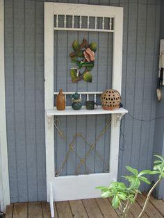 old screen door with shelf