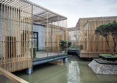 This floating tea house in Yangzhou, by Chinese architects HWCD Associates, features brick rooms linked by louvred bamboo corridors and brises soleil.