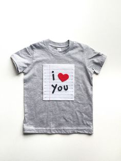This adorable little love note t shirt is made just for you! We hand cut and machine stitch each piece to ensure ease of washing. The lined paper is stitched with red and blue thread.  This is an adorable birthday gift, Valentines Day shirt or everyday clothing