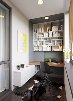 This home office area has been built around an awkward nib to make great use of an otherwise unused corner. Notice how the paint color marks...: