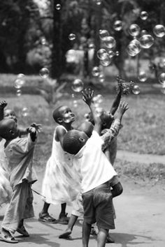 Blowing bubbles with children is part of children Photos Africa - Visit the post for