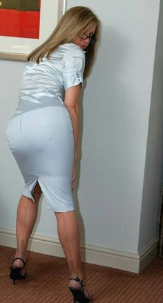 Visible Garter Bumps Under Tight Blue Satin Pencil Skirt Blue Satin Blouse Sheer Back Seam Stockings and Black High Heels