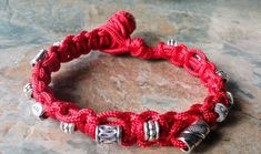 A Lovely Red Paracord Braided Bracelet with Tibetan Silver Bead Detail. Lovely gift for your someone special. Red is thought to be the colour for Good Luck, and also Protection. Red Jewelry, Jewellery, Unique Jewelry, Paracord Bracelets, Beaded Bracelets, Handmade Beads, Handmade Gifts, Silver Beads, Rose Quartz