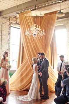 This beautiful criss-crossed sheer fabric makes a very simple, dramatic and amazingly beautiful ceremony backdrop.  dhs