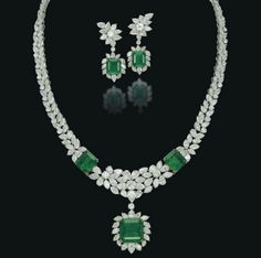A SET OF EMERALD AND DIAMOND JEWELLERY   Comprising a necklace designed as a flexible band of brilliant-cut, marquise and pear-shaped diamonds, enhanced with two square-cut emeralds at the front and suspending a detachable pendant centering upon a square-cut emerald in a pear and marquise-shaped diamond surround, a pair of ear pendants en suite, the back of the necklace can detach to be worn as a bracelet, mounted in platinum and gold
