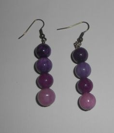 Shades Of Purple Glass Bead Antique Brass Earrings. $7.00, via Etsy.