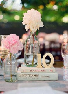 Books are popular as centerpieces, especially with the 'our story' themed weddings.  Instead of collecting books in one color scheme, try to find books with romantic titles or make your own book covers with titles unique to the different chapters of your life together.  Or if the guests at one of the tables share a story with you, title the book about that adventure.
