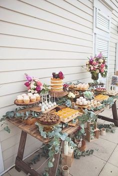 dessert table decorated with eucalyptus