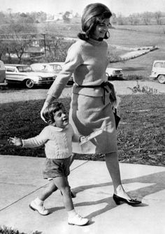 John who seems to be off in his own little world walking with his mother, Jackie.