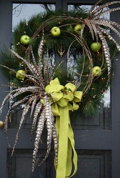 Nothing welcomes guests to your home during the holiday's like beautiful front door decorations. LOVE the green apples and feathers! Holiday Wreaths, Holiday Crafts, Holiday Fun, Christmas Decorations, Holiday Decor, Christmas Door Wreaths, Festive, Noel Christmas, Winter Christmas