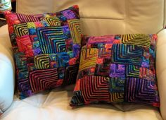 Koigu cushions. She knitted the squares and crocheted them together. No pattern. Picture only. 09-24-14
