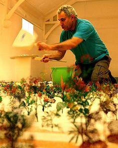 """Zadok Ben David working on his installation """"Blackfield"""" work"""