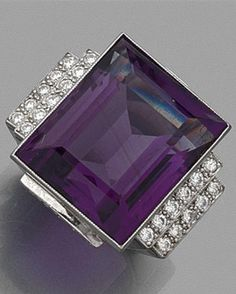 An Art Deco platinum, amethyst and diamond ring, circa 1930. Featuring a large rectangular amethyst weighing 20 carats, flanked on either shoulder by a double line of brilliant-cut diamonds, mounted in platinum. #ArtDeco #ring