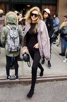 Gigi Hadid.. Kith Classics Astor Ma-1 Jacket, Stuart Weitzman Lowland Boots, Karen Walker Sunglasses, and Rag & Bone Bag..