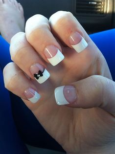 Simple and classic thick French tip with a cute bow. The nails are coated with clear polish as base and tipped with thick white coating. Accenting the nail ensemble is a cute black bow pinned down with a silver bead.