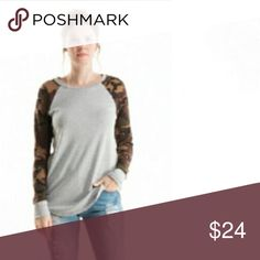 🎉SALE🎉 🌟Camouflage Raglan Top Super comfortable gray top with raglan camouflage sleeves. I typically wear a S or M and I have the XL on in the cover photo. I would size up in this in a heartbeat! Throw your hair in a top knot, and pair with some distressed jeans or black leggings and you're good to go! 💖  👖Materials 80% Polyester • 15% Rayon • 5% Spandex (GREAT quality)  🇺🇸 Made in the USA  💰Bundle 2 items and save 15%  📸 Follow me on IG @cubbycreekboutique Fashionomics Tops Tees…