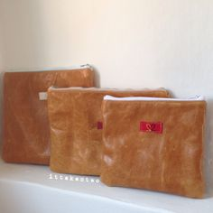Beautiful leather zippy pouches handmade with love and each with different patterned cotton linings and upcycled zips. Made in Italy by IT TAKES TWO