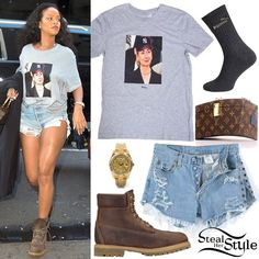 Rihanna was spotted arriving to a recording studio yesterday wearing a Trapvilla Hillary Clinton T-Shirt ($30.00), Levi's Eyelet-Grommet Denim Shorts ($53.00), Puma Crew Socks ($10.00 – 3 pack), her Louis Vuitton X Frank Gehry Twisted Box Bag (Sold Out), a Rolex Day-Date II President Yellow Gold Watch ($35,765.00) and Timberland Premium 6′ Boots ($190.00).
