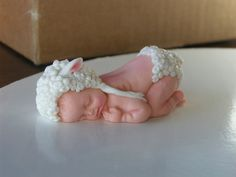 Baby Gumpaste In Lamb Hat And Diaper. Gumpaste Baby from silicone mold. Added lamb detail with gumpaste