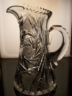CIRCA 1905-1920's AMERICAN BRILLIANT HC FRY CRYSTAL CUT GLASS  PITCHER JUG -EXC  #HCFRY. Asking $255 plus $20 s/h on e-bay with 3 offers and 17 watchers as of 9-17-14. Looks just like the one we bought at the Bell Auction in 2013. Sandra paid $50 for pitcher and 4 glasses (1 chipped).