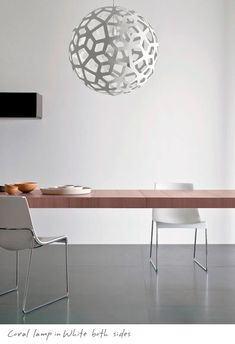 This light transforms in each space. The White on White Coral light looks amazing in this modern space.
