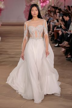 Gorgeous sheer wedding dress with embroidered detailing.