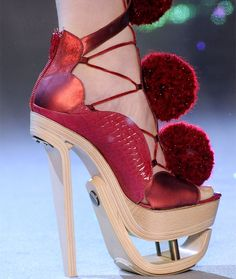 56fb173b750e Poodle Shoes - The pom-poms on these John Galliano shoes remind me of the  haircuts people give to their poodles to create perfectly coiffed little  puffy ...