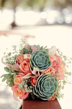 Grooms home state succulents at Rehearsal dinner?  Peach & Mint Bridal Bouquet with~ green succulents, salmon roses, blush callas and eucalyptus. Dru loves Hens and Chicks.
