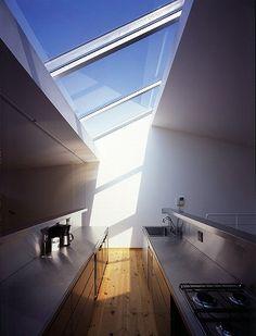 Simple, beautiful slanted skylight in a sleek minimal kitchen