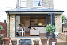This light and airy kitchen diner in a rear extension in south London features an open plan space ideal for families. For more kitchen extension ideas have a look on our website. Kitchen Extension Open Plan, Extension Veranda, House Extension Plans, Side Return Extension, House Extension Design, Roof Extension, Extension Ideas, Conservatory Extension, 1930s House Extension