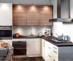 Our kitchen cabinets, Ikea Sofielund. We have wooden bottom cabinets and white top cabinets.
