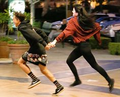 Kylie Jenner and Jaden Smith grab hands running in Calabasas, CA. Young love?