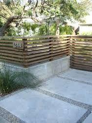 Bildergebnis für landscape retaining walls with fences installed on top